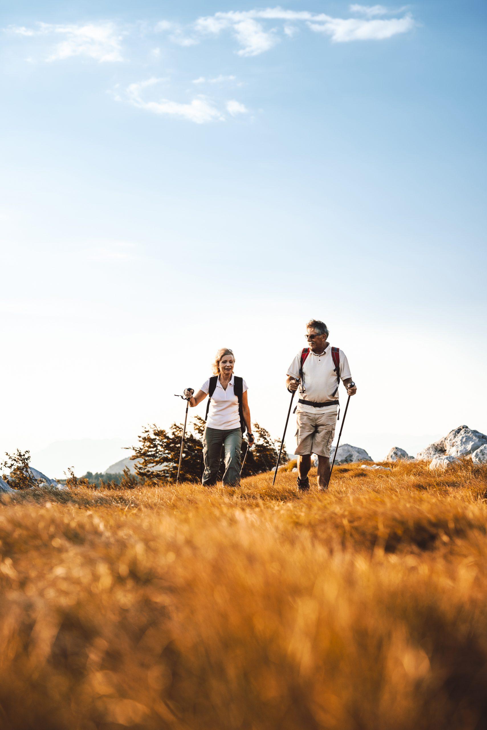 Heterosexual senior couple hiking